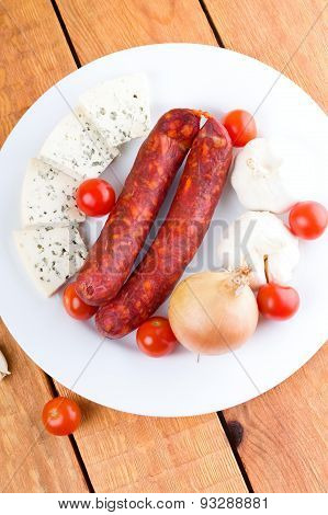 Top View On Plate With Sausages Vegetable And Cheese
