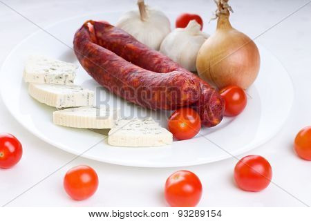 Two Spicy Pork Sausages On White Plate With Various Vegetable