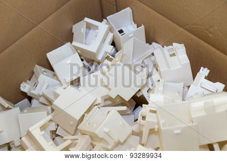 Plastic Parts Are Packed In A Cardboard Box