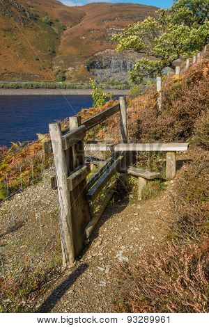 Wooden  Stile Style, Over Fence, With Bracken. Lake And Mountain