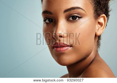 Pretty Black Woman's Closeup Portrait. Blue Background