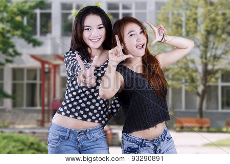 Cheerful Girls With Funny Poses At Schoolyard