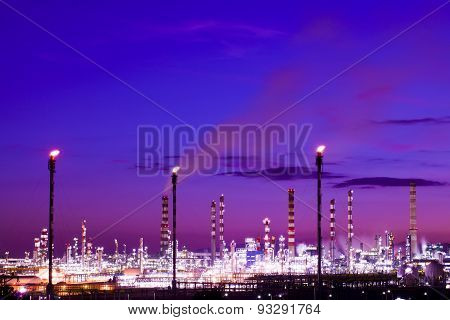 Oil refinery plant at night Fire and smoke comming out from chimneys