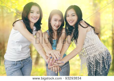 Girls Joining Hands In The Nature
