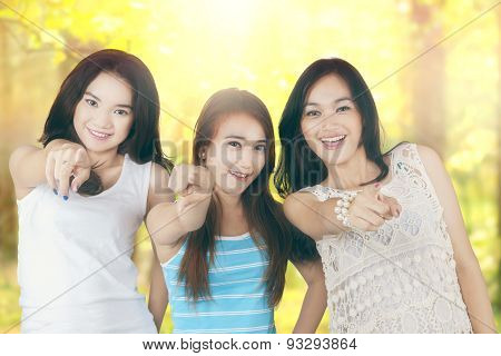 Girls Pointing At The Camera In The Nature