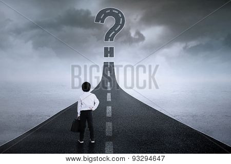 Little Businessman With Question Mark At Street
