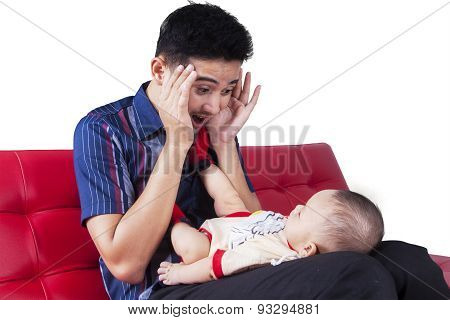 Man Play Peekaboo With His Child