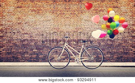 bicycle vintage with heart balloon
