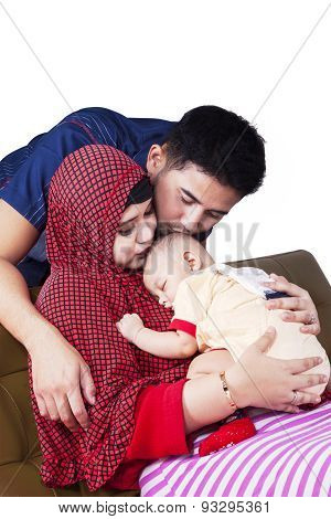 Muslim Parents Kiss Their Baby