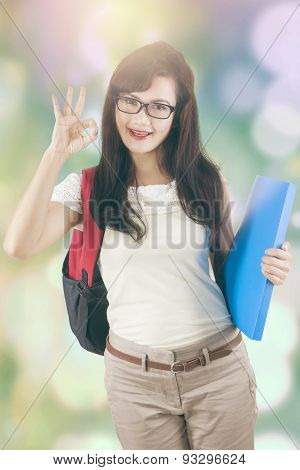 Student With Okay Sign And Bokeh Background