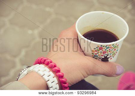 Takeaway Coffee In A Female Hand