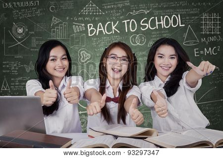 Three Female Students Showing Thumbs Up
