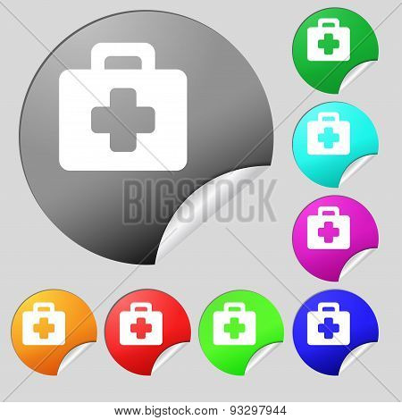 First Aid Kit Icon Sign. Set Of Eight Multi Colored Round Buttons, Stickers. Vector