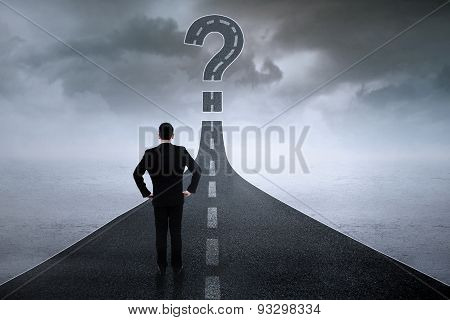 Worker With Question Sign On The Road