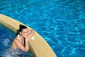 stock photo of relaxing  - Beautiful happy woman enjoying relax in spa at resort pool - JPG