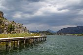 foto of dalyan  - Side view of wooden pier in the river between Koycegiz Lake and Iztuzu Beach in Dalyan - JPG