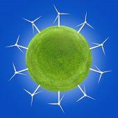 foto of wind energy  - Wind turbines around a green planet symbolizing clean energies - JPG