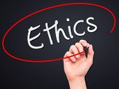 picture of ethics  - Man hand writing Ethics on visual screen - JPG