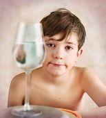 image of preteen  - keen preteen boy investigate reflection behavior in water  - JPG
