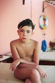 foto of preteens  - preteen handsome boy after swimming dramatic wet close up portrait - JPG