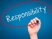stock photo of responsible  - Man hand writing Responsibility on visual screen - JPG