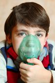 image of inhalant  - boy with electric inhaler as a curation against virul disease flue - JPG