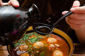 foto of noodles  - Pouring wine into a bowl of Chinese noodle - JPG