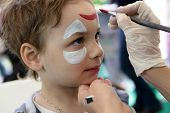 foto of face painting  - Child with painting face at the amusement park - JPG