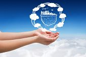 image of presenting  - Hands presenting against blue sky over clouds - JPG