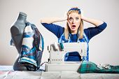 pic of thread-making  - Woman sews and realizes that she is making mistake - JPG