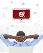 stock photo of video chat  - Relaxed businessman sitting in his chair against video chat graphics - JPG