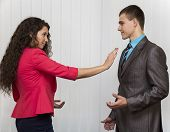 foto of inappropriate  - conflict between male and female corporate workers