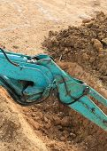 stock photo of excavator  - arm of excavator tractor working in construction site - JPG