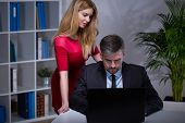 image of inappropriate  - Sexy secretary in red dress seducing her boss - JPG