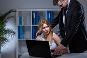 stock photo of office romance  - Adult manager and beauty secretary flirting in office - JPG
