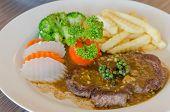 stock photo of peppercorns  - close up beef steak with green peppercorn sauce - JPG