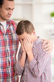 stock photo of crying boy  - Boy crying while father scold him - JPG