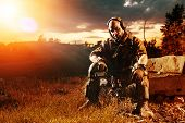 image of m4  - American soldier with the M4 rifle is having a rest - JPG