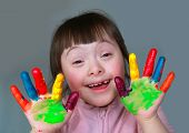 stock photo of little school girl  - Cute little girl with painted hands - JPG