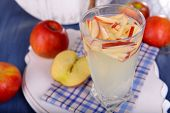 stock photo of cider apples  - Glass of apple cider with fruits on table close up - JPG