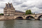 Постер, плакат: Pont Royal Over Seine In Paris With View At The Louvre