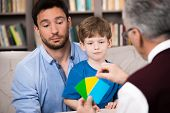 picture of psychologist  - Little boy and his father talking with psychologist - JPG