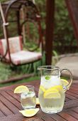 pic of cold drink  - Pitcher and glasses of fresh lemonade in the garden - JPG