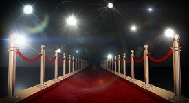 picture of roping  - Red carpet with gold barriers velvet ropes and flashlights in the background - JPG