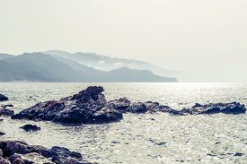 pic of mountain-high  - Inspirational beautiful mountains landscape with sea sharp rocks and high mountains in background at sunrise on Crete Island Greece - JPG