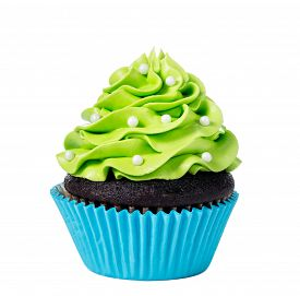 picture of icing  - Chocolate cupcake decorated with green icing and sprinkles isolated on white - JPG
