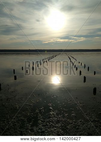 sunset and reflection in hadzhibeevskim salty estuary in Odessa