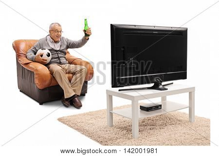 Thrilled mature man sitting on an armchair having a beer and watching football on TV isolated on white background