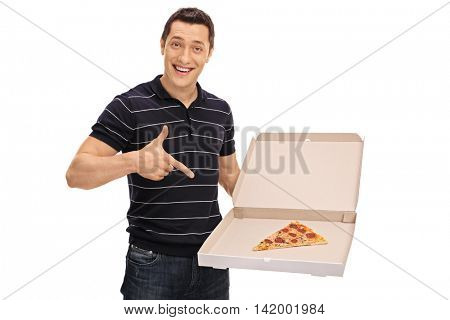 Cheerful guy pointing at a slice of pizza and looking at the camera isolated on white background