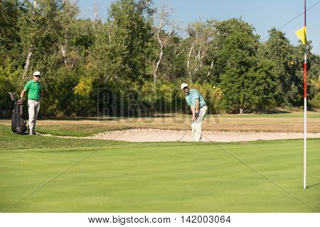 Golfer Playing From Sand Trap